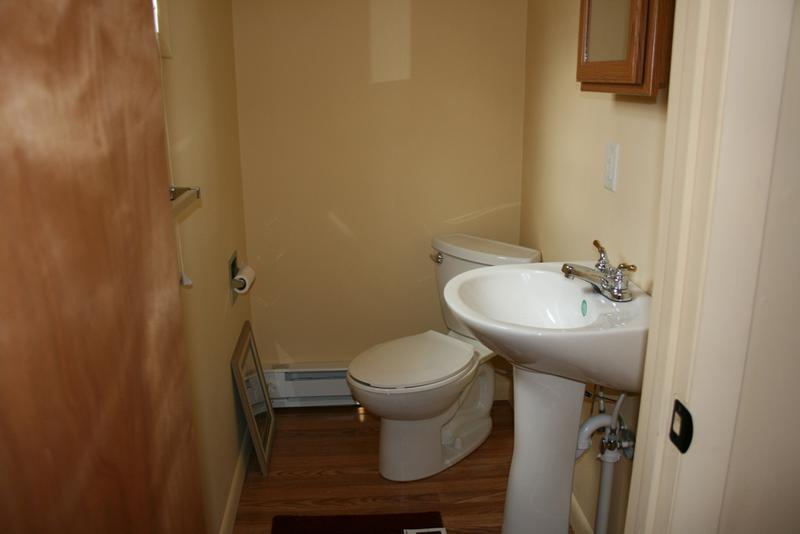 Half bath off twin bedroom